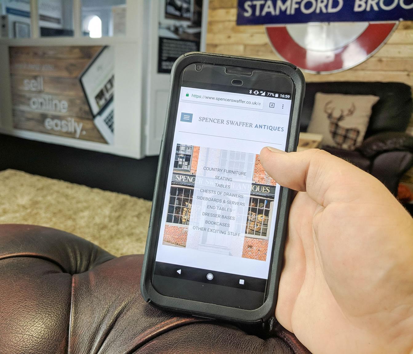 Spencer Swaffer Antiques website on a phone